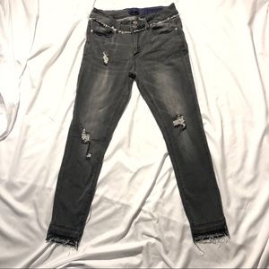 FREE W/ PURCHASE Distressed gray skinny jeans